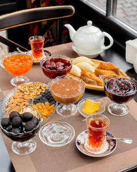 Tea set with different types of jams, baklava, shekerbura, dry fruits and nuts