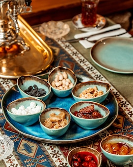 Tea set with dried fruits nuts and jams