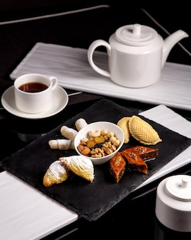 Tea set with shekerbura, baklava, badambura and dried fruits and nuts