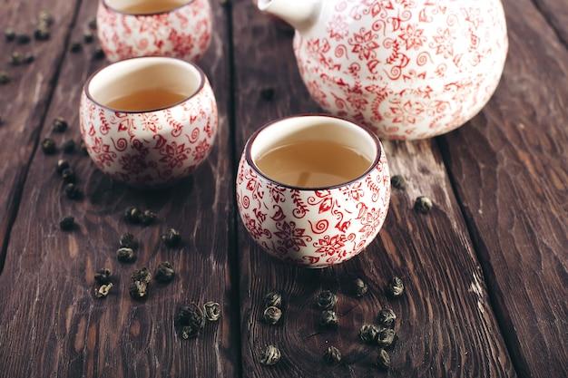 Tea set on a wooden background