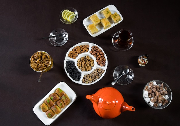 Tea table with tea glasses, nuts and top view.