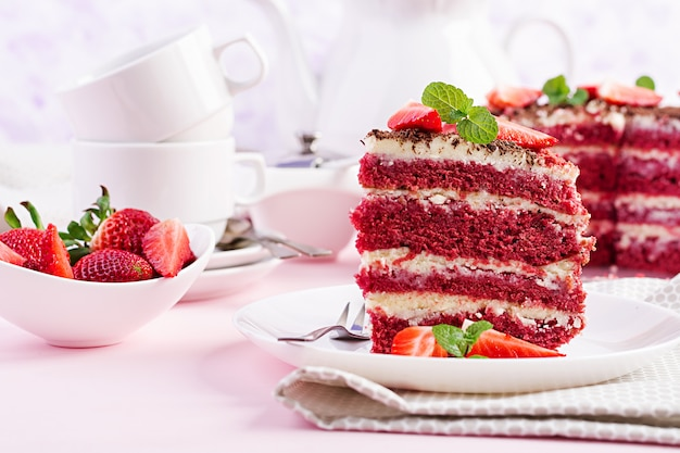 Tea time with red velvet cake and strawberries