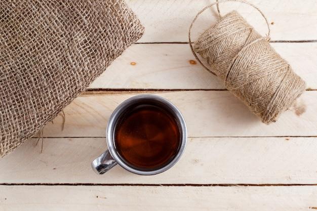 Tea in vintage mug on wooden table