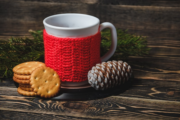 Tea in white cup and christmas decor