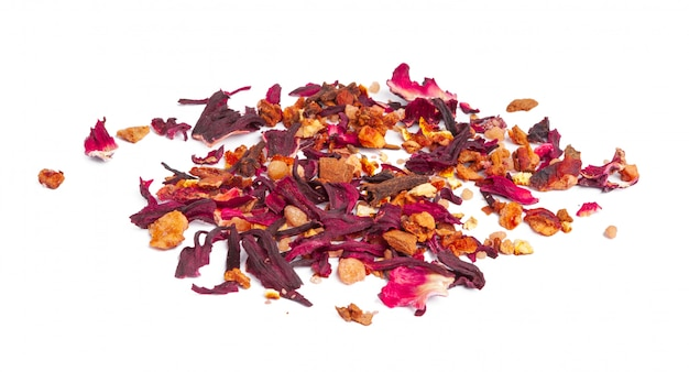 Tea with candied fruit and rose petals isolated