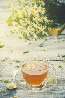 Tea with chamomile. selective focus. food and drink.