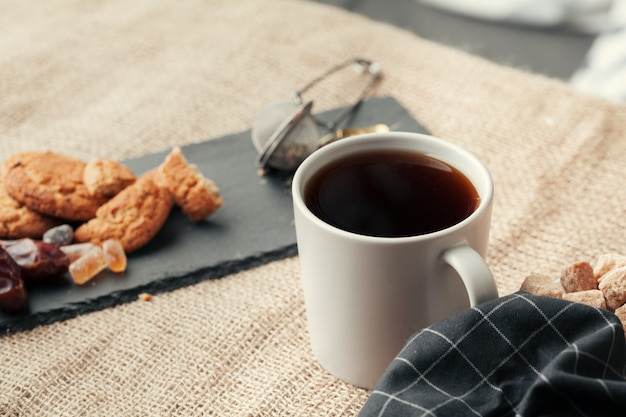 Tea with cookies on sackcloth background