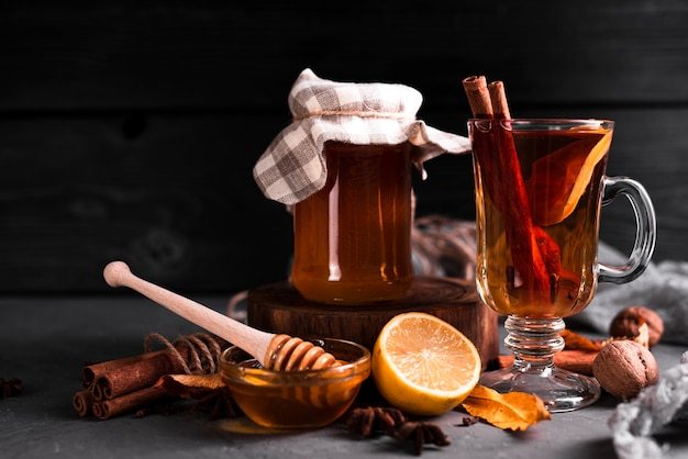 Tea with honey and black background
