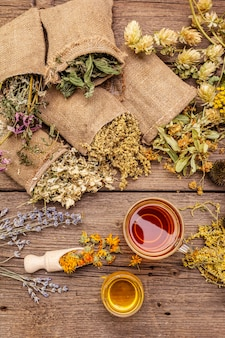 Tea with honey. herbal harvest collection and bouquets of wild herbs. alternative medicine. natural pharmacy, self-care concept