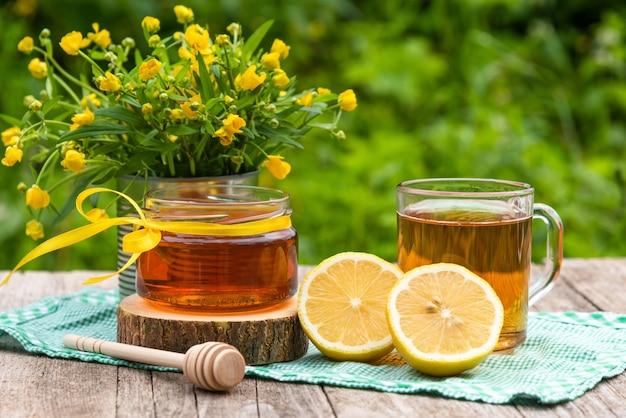 Tea with lemon and honey for breakfast