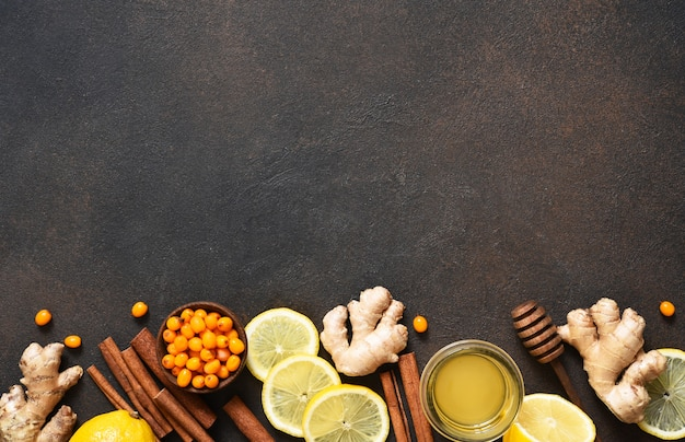 Tea with lemon, honey and cinnamon. ingredients for making tea. hot winter drink with ginger and sea buckthorn.