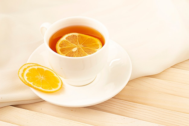 Tea with lemon on a light and wooden table