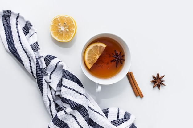 Tea with lemon near striped cloth