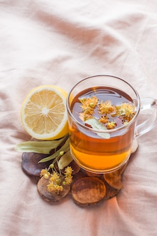 Tea with linden, honey and lemon. the tray on the bed, the concept of the treatment of colds