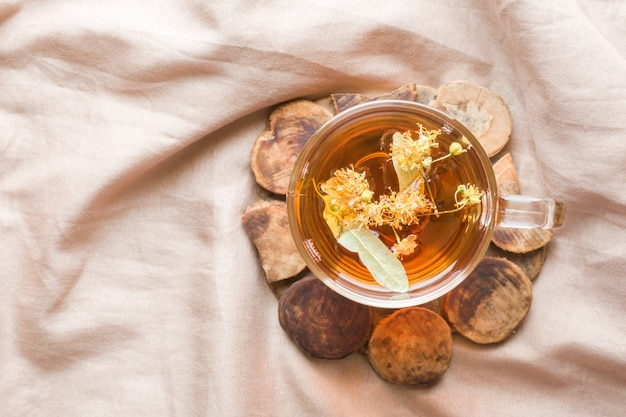 Tea with linden. the tray on the bed, the concept of the treatment of colds