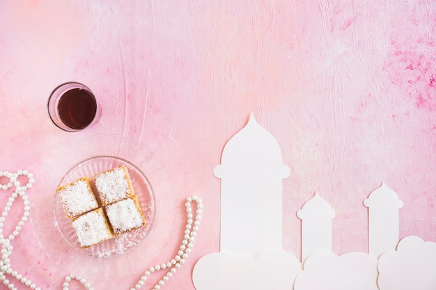 Tea with sweets and mosque cut out