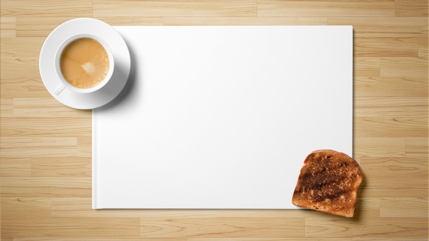 Tea with toast on white paper on wooden background