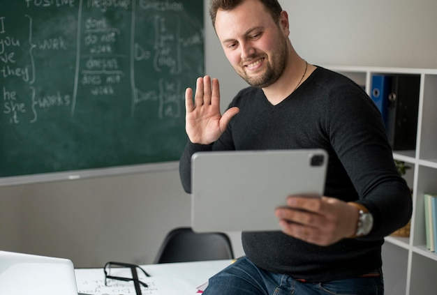 Teacher doing an english lesson online for his students