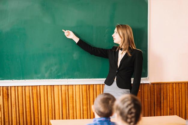 Teacher explain something to pupil