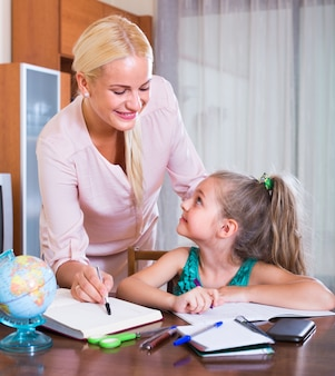 Teacher and girl studying at home