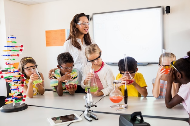 A teacher having science lesson