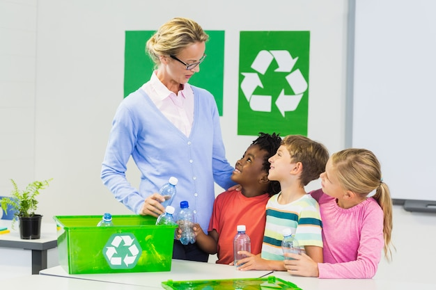 Teacher and kids interacting with each other in classroom