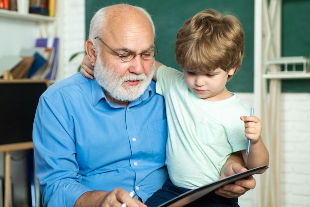 Teacher and pupil learning together in school