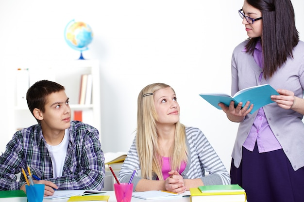 Teacher reading an essay