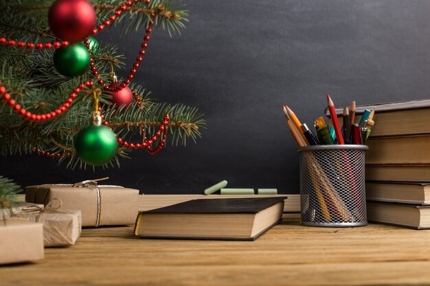 Teacher's table with books, organizer and chalkboard