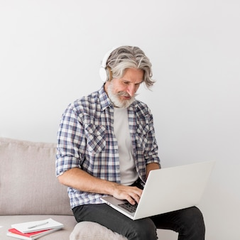 Teacher staying on couch using laptop