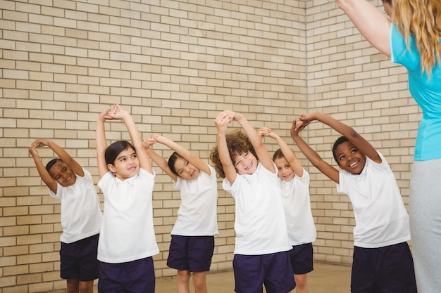 Teacher and students doing stretches
