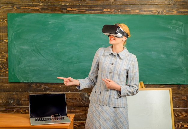 Teacher with laptop teacher in vr headset with laptop back to school online education education
