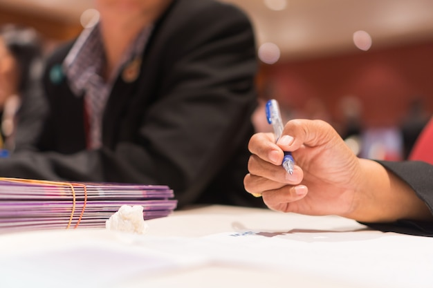 Teacher woman hands holding pen for checking signing