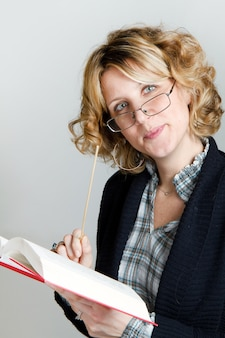 Teaching woman  with book