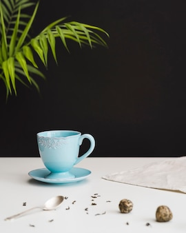 Teacup and plate on table