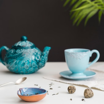 Teacup and teapot on table