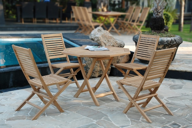 Teak garden furniture set with folding chairs and hexagonal table