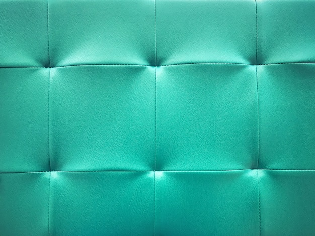 Teal blue tone color sofa surface texture background.
