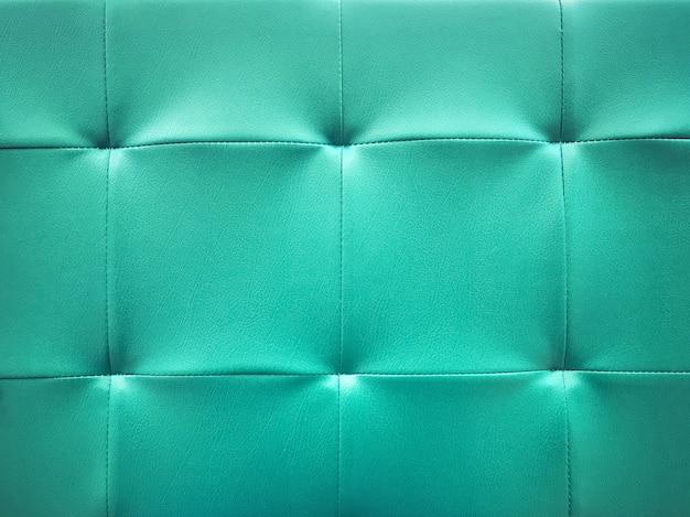 Предпосылка текстуры поверхности софы цвета тона teal голубая.
