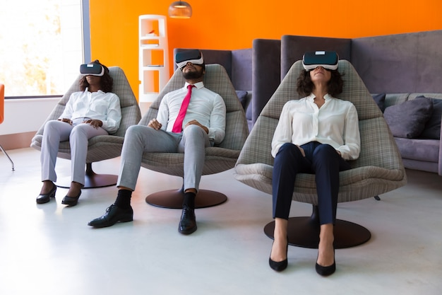 Team of business colleagues enjoying vr experience