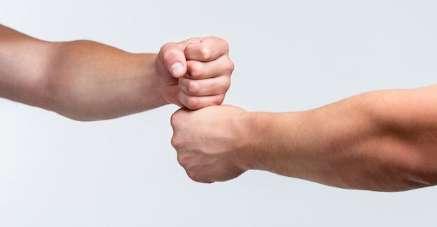 Team concept. people bumping their fists together, arms. friendly handshake, friends greeting. two hands, isolated arm. hands of man people fist bump team teamwork, success. man giving fist bump.