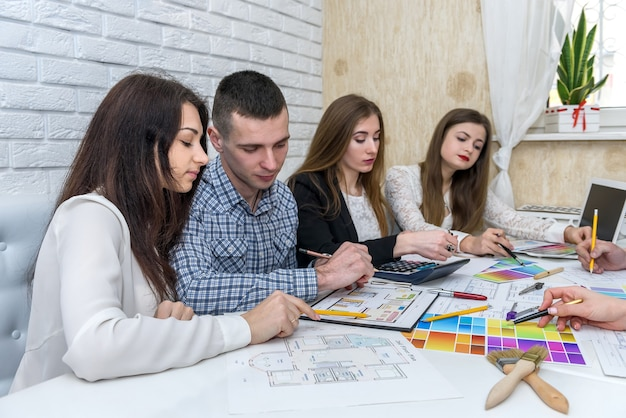 Team of creative designers discussing colour swatch