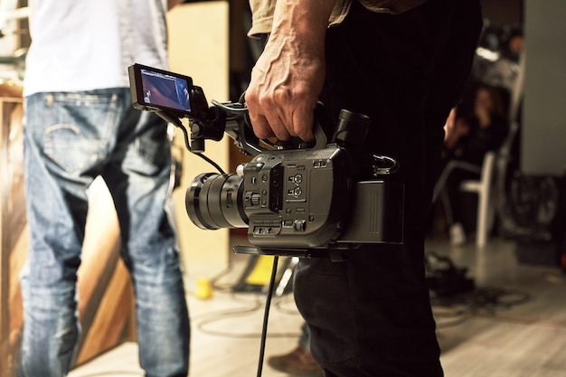 The team of the director, videodeoperators and actors works on the site. video production, backstage, video content production.