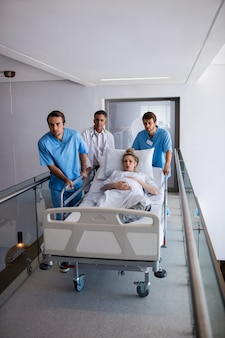 Team of doctors taking a pregnant woman to operation theatre