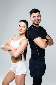 Team of fitness coaches man and woman isolated on white background