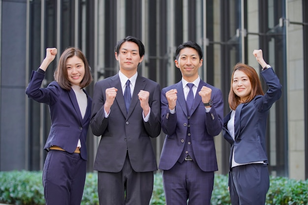 Team of four businessmen and women