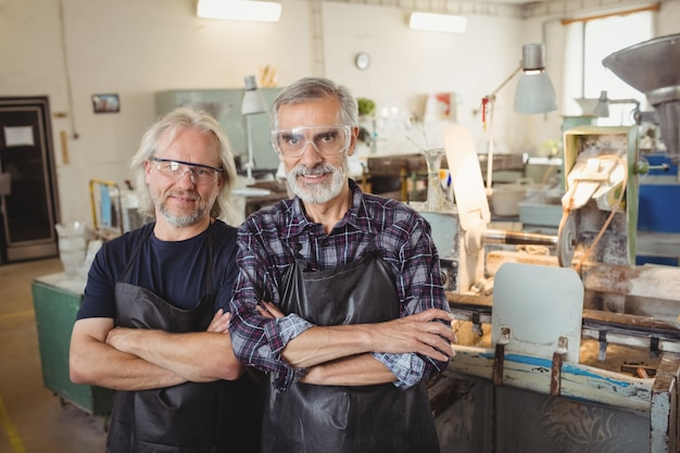Team of glassblowers with arms crossed