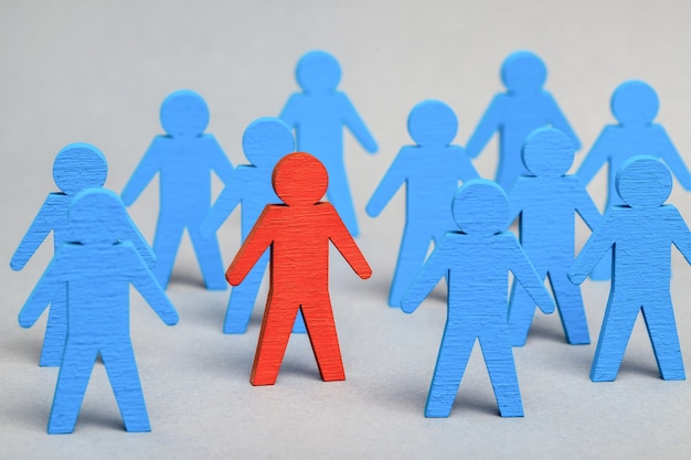 Team leader. hr. the right choice of staff. blue men and red leader.
