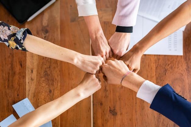 Team making a group fist bump