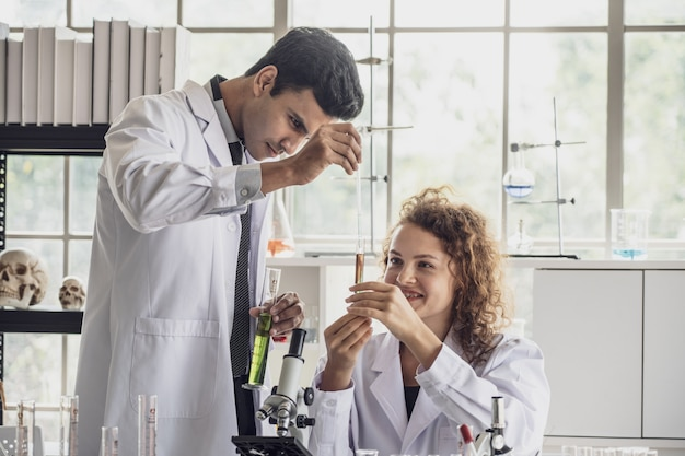 Team of medical research scientist conducts experiments in laboratory.